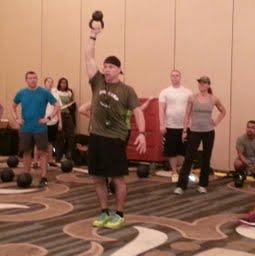 Todd Durkin balancing a kettleball during bootcamp